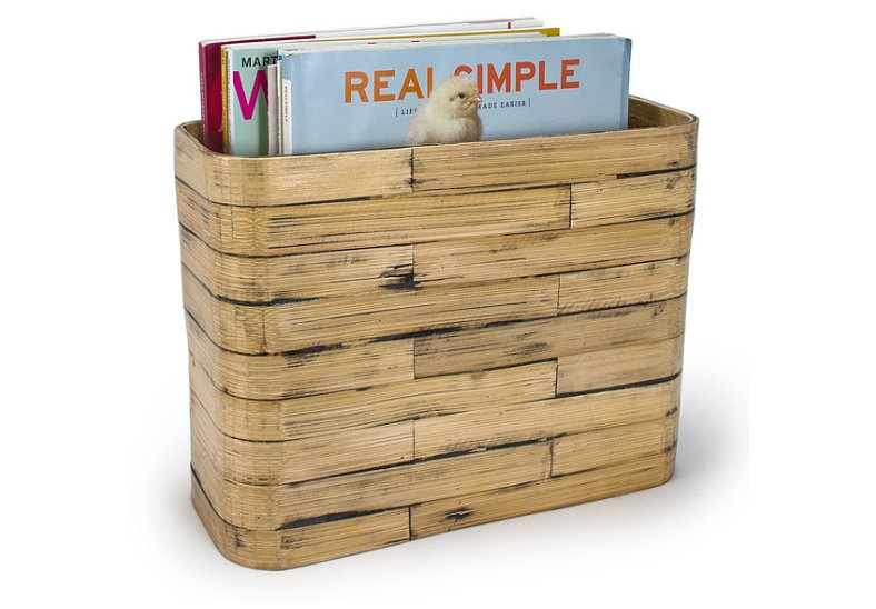 This natural bamboo basket ($50) is a versatile piece that can be used to store magazines or as a flower box.