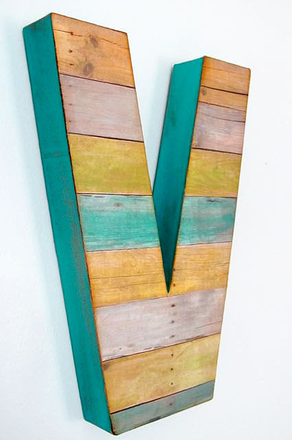 Create a unique gallery wall by hanging a custom reclaimed-wood letter ($25) or two!