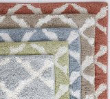 This bath rug ($34) has a subtle pattern that is neutral enough to work well with your other linens and towels.