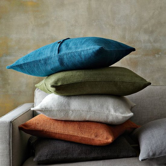 Handcrafted through a sustainability project, these silk pillow covers ($25-$34) will bring natural tones and textures to your home's seating.