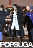 Maggie Q tried to keep warm on the Nikita set in Toronto on Sunday.