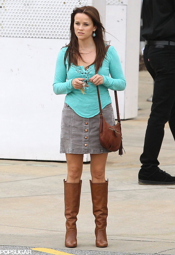 Reese Witherspoon wore boots with a skirt on her The Good Lie set in Atlanta.