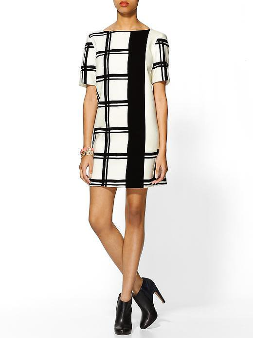 Tibi's checkered border short-sleeved dress ($281, originally $375) would look as cool now with white heels as it will come Fall with a pair of black booties. Translation: it's worth the investment.