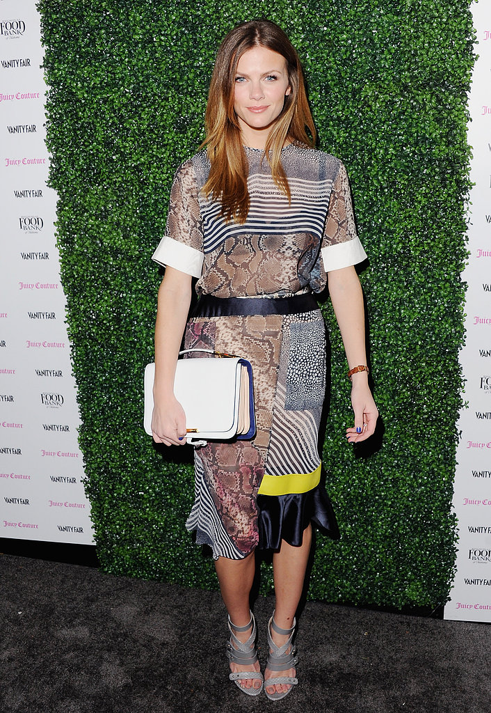 Brooklyn took the fashion-forward approach in a snake- and stripe-print Preen sheath at the Vanity Fair and Juicy Couture celebration of the 2013 Vanities Calendar.