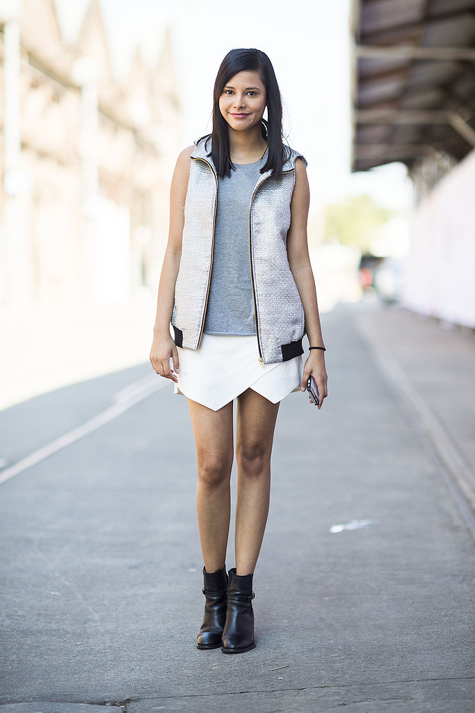 A white mini got toughened up with a sporty vest and black booties. Source: Le 21ème | Adam Katz Sinding