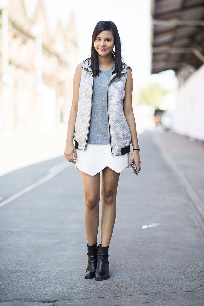 A white mini got toughened up with a sporty vest and black booties. Source: Le 21ème | Adam Katz Sinding
