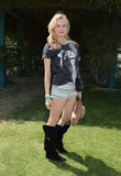 Diane Kruger got into mini tribal-print shorts, a band tee, and black knee-high boots at H&M's Coachella bash. Of course, she didn't leave home without statement accessories: a mini black crossbody bag and a tan wide-brim hat.