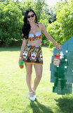 Katy Perry showed how to work playful and sexy in a printed bustier halter top and a miniskirt at the Lacoste pool party at Coachella.