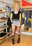 Singer Sky Ferreira posed in a denim skirt, a wide-brim hat, and a black leather backpack at the Forever 21 Desert Disco.