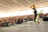 Grimes ran back and forth on the stage in front of a large crowd on Sunday.