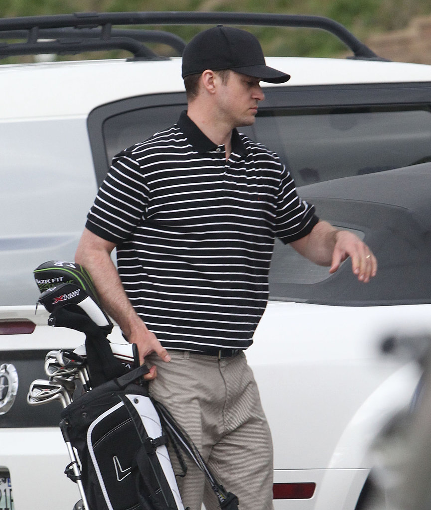 Justin Timberlake prepared to leave the Mirimichi Golf Course in Millington, TN, after a round of golf with wife Jessica.