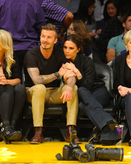 David and Victoria Beckham cuddled up courtside at a Lakers game in May 2012.