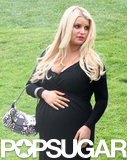 Jessica Simpson showed off her baby bump in a black dress.