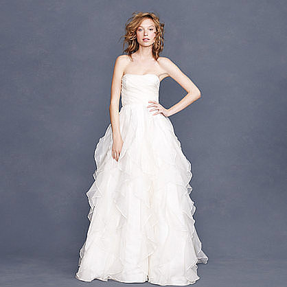 Want to have a princess moment? Then definitely hop on this J.Crew strapless silk organza ruffle gown ($2,400). We recommend adding a jewelry belt for an even more glitzy vibe.