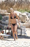 Kate Hudson showed off her toned, tan body in a black Chloé bikini while hitting the beach in Greece in July 2012.