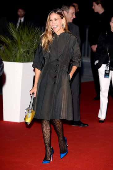 Sarah Jessica Parker wore bright blue shoes for the Calzedonia show in Italy.