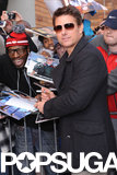 Tom Cruise signed autographs and mingled with fans.