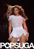 Beyoncé looked out on her fans wearing a white, sheer striped leotard with nude fishnet tights — we especially love the fringed shoulder detail.