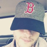 Ashton Kutcher shared his support for the city of Boston by sharing this photo while wearing a Red Sox cap. Source: Twitter user aplusk