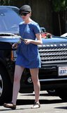 Anne Hathaway enjoyed a sunny day in LA wearing a short-sleeved denim dress, a long gold leaf necklace, jeweled sandals, a black cap.