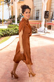 Salma Hayek strutted her stuff in a rust-colored Gucci dress.