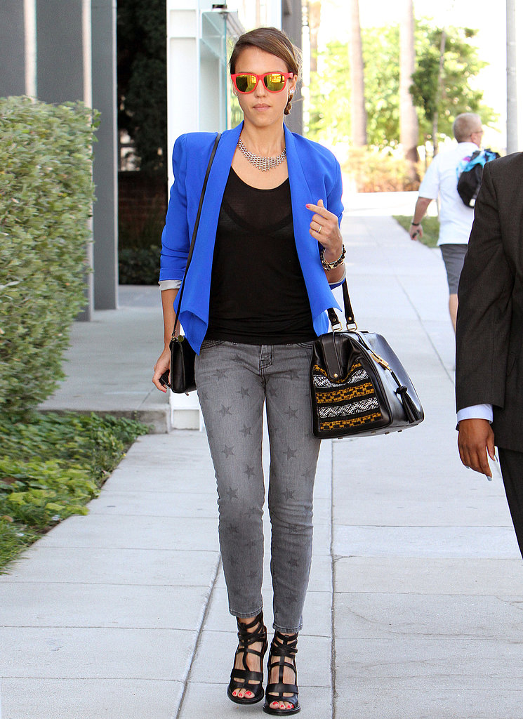 Jessica showcased yet another cool-girl style, pairing a cobalt Kate Frances blazer with gray star-print Current/Elliott skinny jeans, black cage sandals, and a Cobra Society satchel in LA.