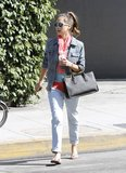 Jessica topped her cuffed trousers with a colorblock blouse, denim jacket, and structured Prada tote in Beverly Hills.