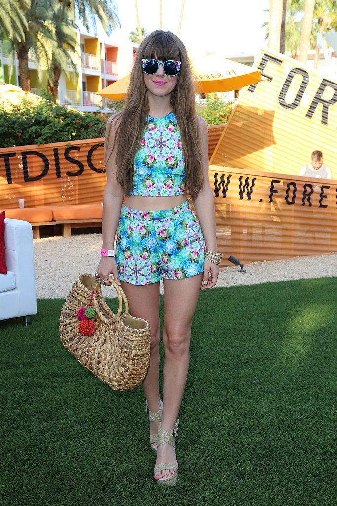 This party goer made a bold statement in vibrant prints, statement shades, and cute straw bag at the Forever 21 Desert Disco party. Source: Rachel Murray/Getty Images