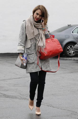 Jessica Alba proved the power of a statement coat in a tweed H&M creation, paired with dark skinnies, while shopping around LA.