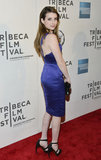 Emma Roberts posed in purple on the red carpet for Adult World.
