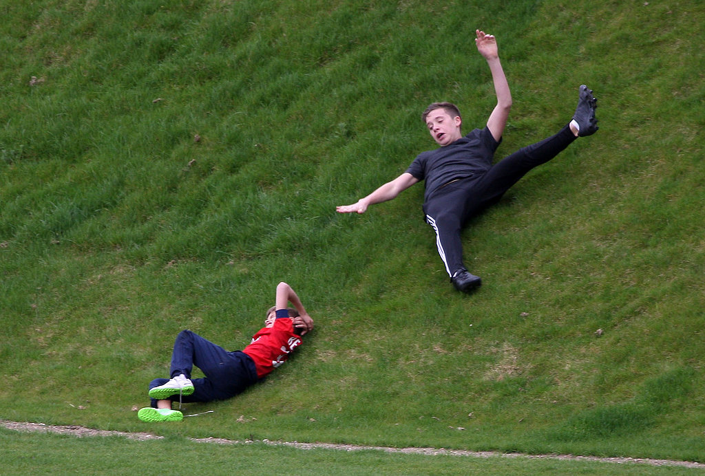 Brooklyn and Romeo Beckham rolled down a hill when breaking from soccer training.