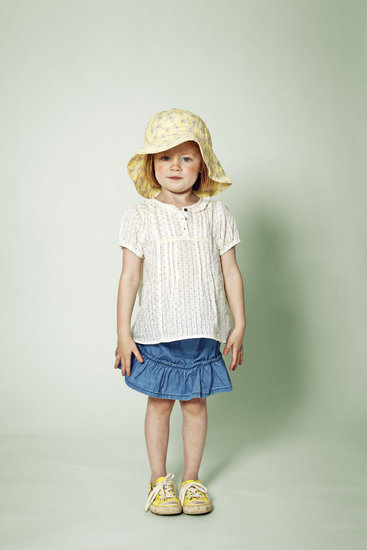 An adorable ensemble for a little girl, this floppy hat and ruffled skirt are chic and sunny.