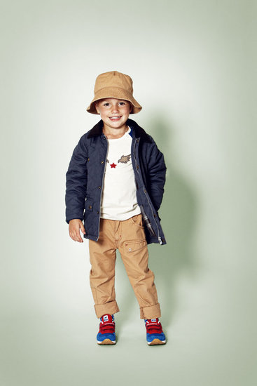 This polished little boy's look combines classic khakis with a go-with-everything quilted zip-up jacket.