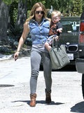 Hilary Duff carried her son, Luca Comrie, to a party in LA on Saturday.