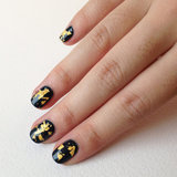 Creating your own gold-leaf top coat is easy to do and makes for a stunning nail design with minimal effort.