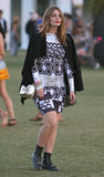 Mischa Barton wore a geometric-print dress with combat boots, a black coat, and a gold metallic bag at Coachella.