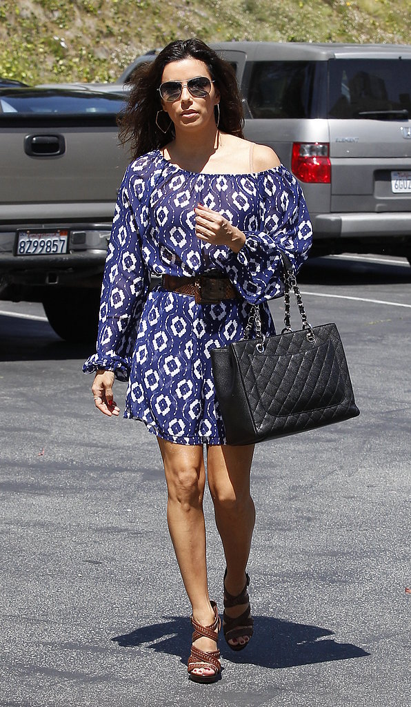 Eva Longoria ran errands in LA wearing a printed off-the-shoulder dress by Show Me Your Mumu with brown studded Brian Atwood sandals, aviator sunglasses, and a black quilted Chanel bag.