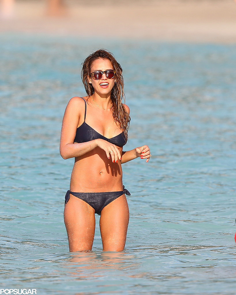 She wore a shiny black bikini during a trip to St. Barts in April 2013.