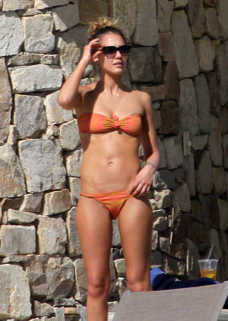 In January, Jessica Alba worked on her tan in Cabo while wearing a bandeau bikini.