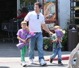 Mark Wahlberg walked through a parking lot with his sons, Michael and Brendan.