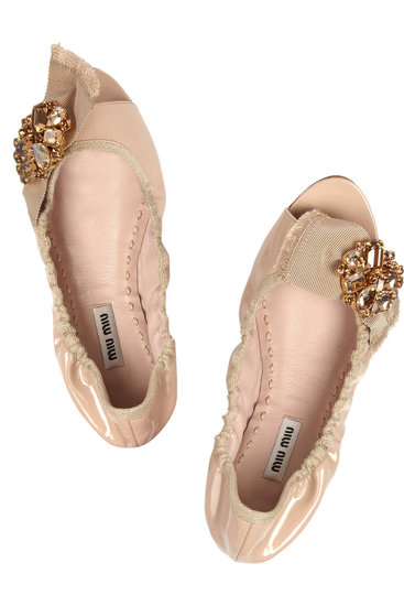 A lot of brides choose nude shoes for their big day, and it's no wonder why: they go with everything and look sleek, clean, and crisp under your dress. For a nude flat with some attitude, we love Miu Miu's Embellished Patent-Leather Ballet Flats ($660).