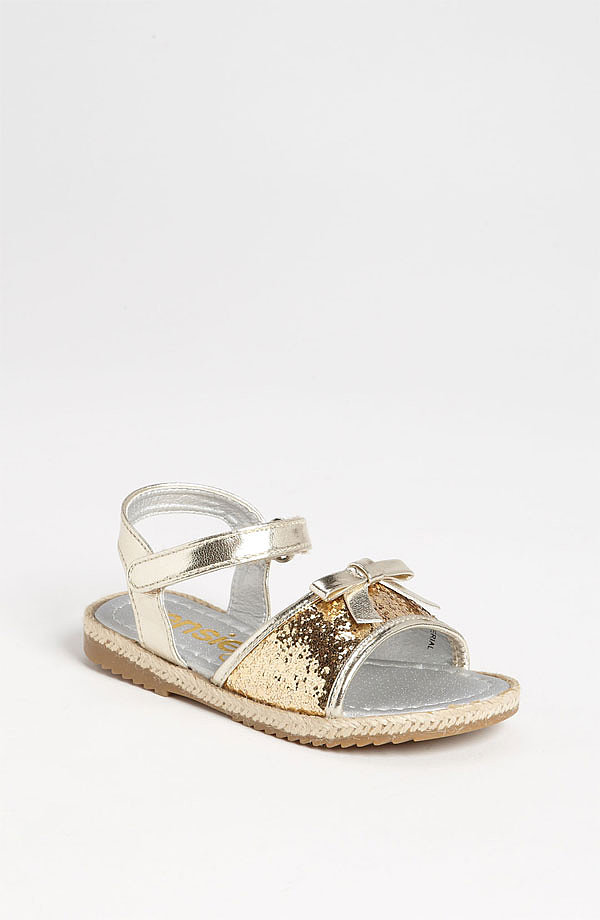 Kensie's sparkly glitter sandals ($38) come in silver and gold and will make her the most glam gal on the playground.