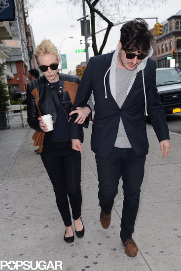 Carey Mulligan held Marcus Mumford's arm  as they walked down the street.