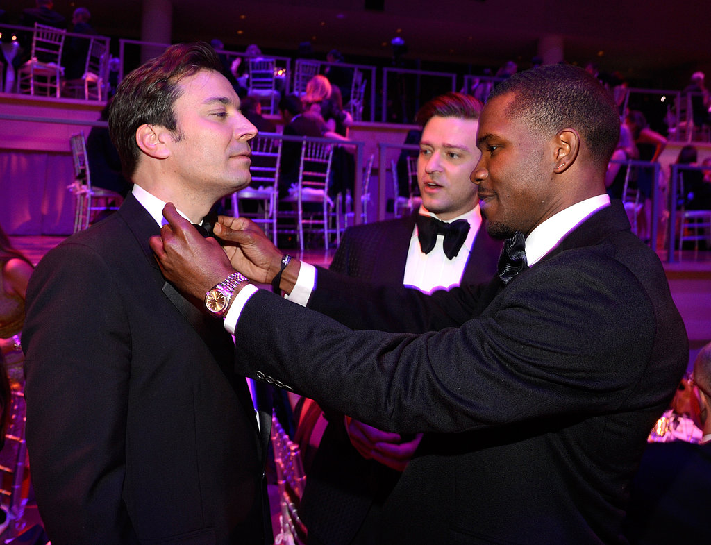 Frank Ocean adjusted Jimmy Fallon's tie, while Justin Timberlake looked on.