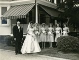 Bridesmaids wore bonnets at this mid-'50s wedding.  Source: Flickr user Striderv