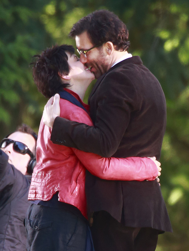 Clive Owen kissed his Words and Pictures costar Juliette Binoche while on set in Vancouver on Monday.