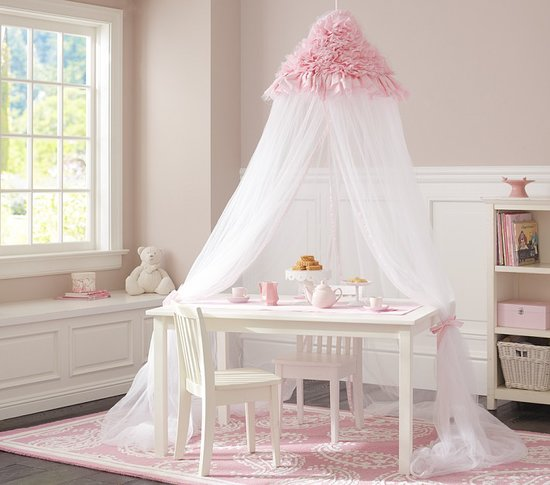 Make teatime whimsical with this ruffled pink canopy ($139). It's also a fitting choice over her bed too.