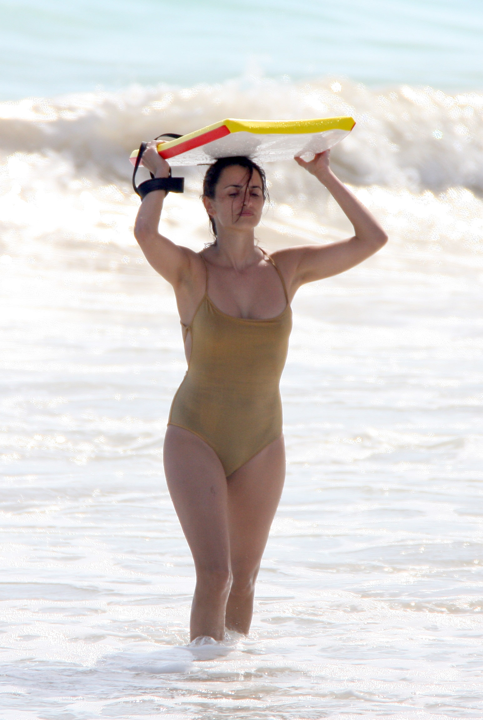 Penélope Cruz hit the waves in a barely there swimsuit while vacationing in St. Barts in January 2007.