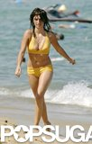 She wore a bright yellow bikini while walking on the beach in St.-Tropez in July 2006.