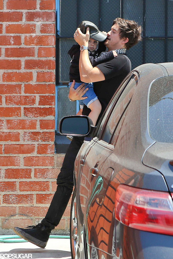 Orlando Bloom carried his son, Flynn.